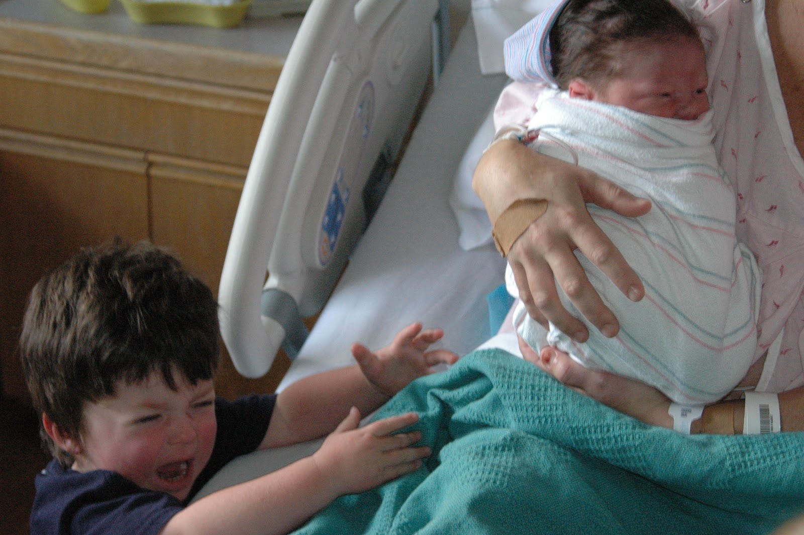 Beau felt an instant desire to hold his baby brother for the first time.
