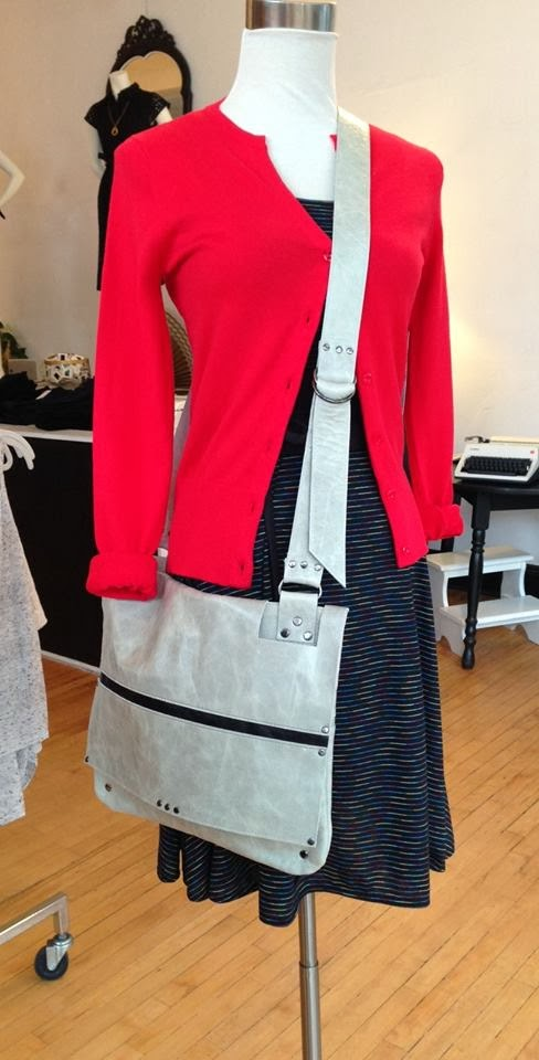 Lucy dress by Sarah Bibb, red cardigan by Kersh, and Mae bag by Cipriano Designs at Folly