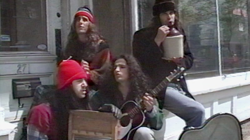 The band Flesh performing on the street.
