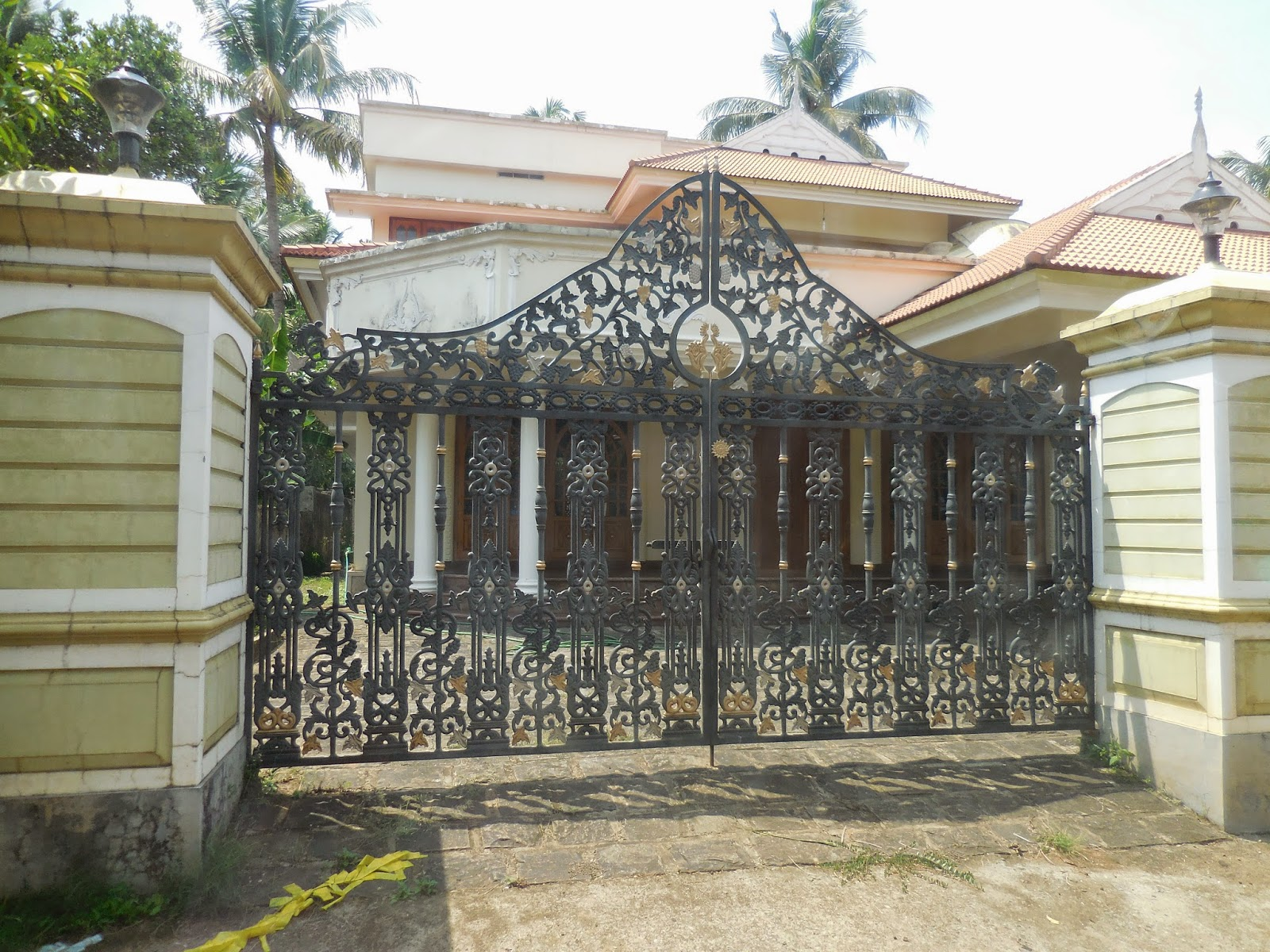 Kerala Gate Designs: Houses gates in Thrissur District, Kerala on modern house design, house pool design, house wall design, drive gates design, house floor plans, house architecture design, house balcony design, house green design, safe house design, house flower garden design, house fence design, house floor design, driveway gates design, house carport design, house exterior and interior design, find and design, modern stair wall design, house living room design, iron works design, house design styles,