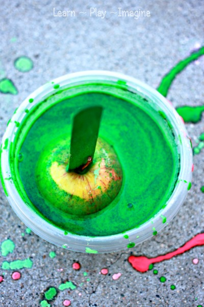 Apple printing with scented sidewalk chalk paint - awesome fall fun for kids!