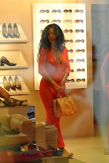 Rihanna looking at shoes and sunglasses