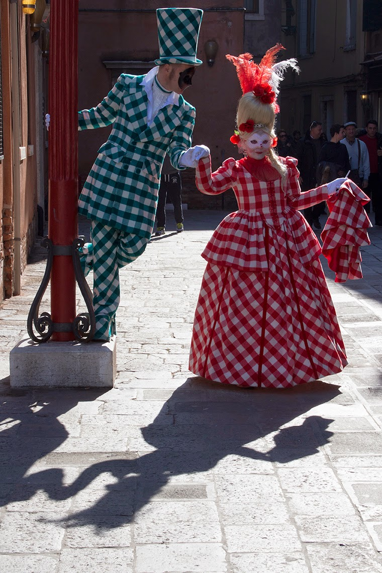 costumed couple playing with shadows
