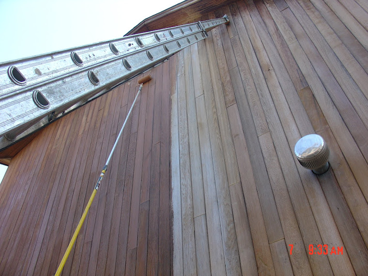 Long pole and ladder help us when staining exterior siding, Long Island NY