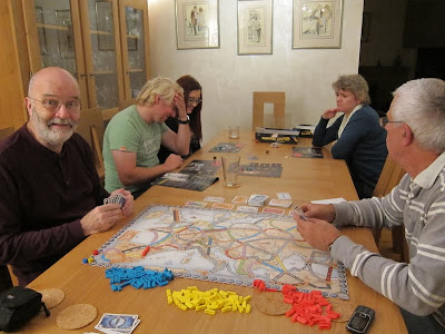 Ticket To Ride: Europe - Crispin spots I have the camera and Daniella doesn't look happy at how the other game is going