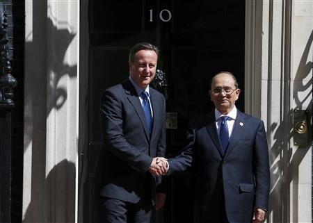 Britain's Prime Minister David Cameron greets the President of Burma