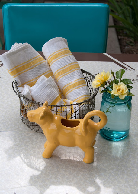 Table top - vintage table, blue mason jar, yellow tea towels, yellow cow creamer