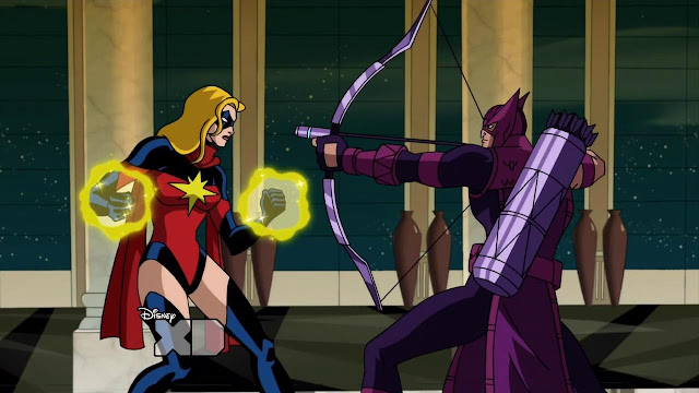 Hey, Ms. Marvel, you don't need to defeat Hawkeye with your powers. Just grab that skirt of his and flip it over his head.