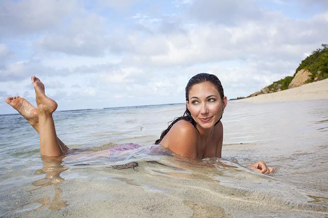 Amy West on the beach at Scrub Island