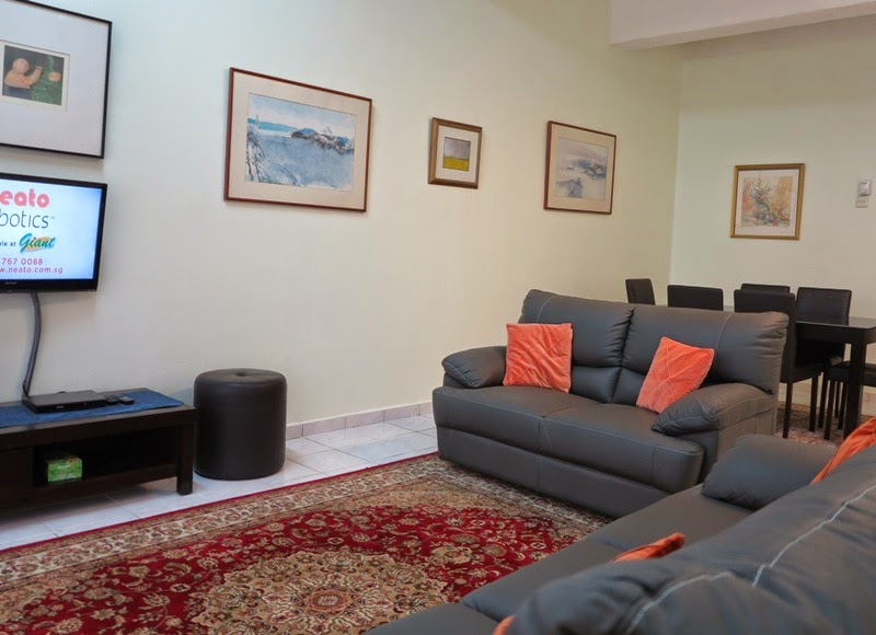 "Photo 1: Living room full leather 3+2 sofa, 32"" TV, fan"