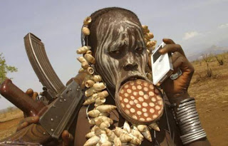 ... Store . Its an African Tribal Warrior with an AK47 and a iPod