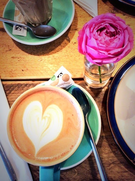 Wildflower Cafe Notting Hill Hot chocolate in mug, heart in the froth and flower next to it