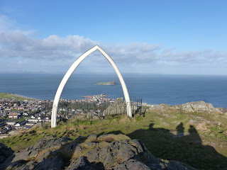 Whale jaw bone on North Berwick Law, the Forth behind