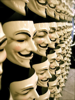 Guy Fawkes masks filling up a store display shelf