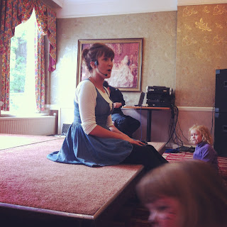 Katy Ashworth performing at the South West Baby Show