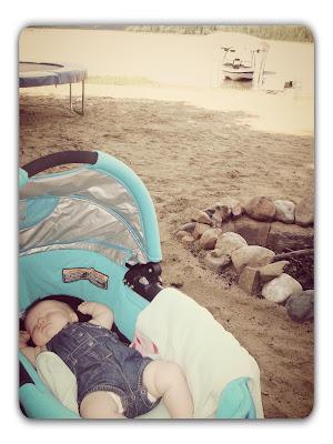 Baby sleeping at the lake