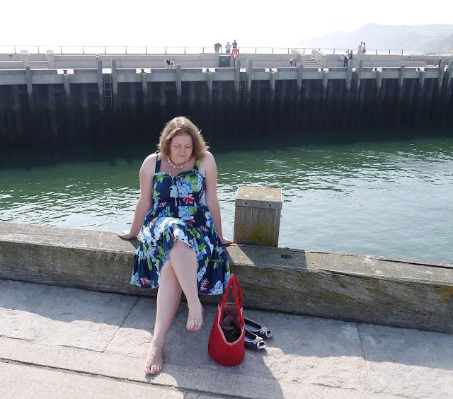 Girl in Dress Sat on Harbourside