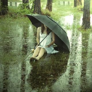 alone girl with black umbrella in rain