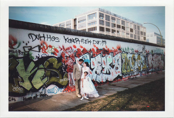 dirty photos - Once - street photo of married couple and kid at the wall of berlin