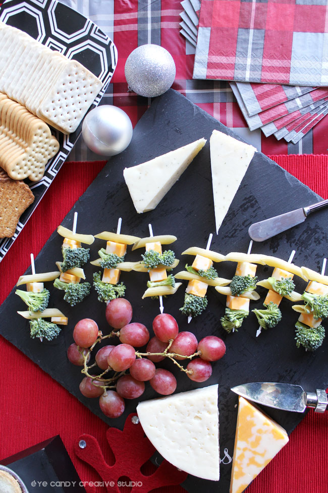 cheese tray, pepperidge farm crackers, cheese spreader, grapes