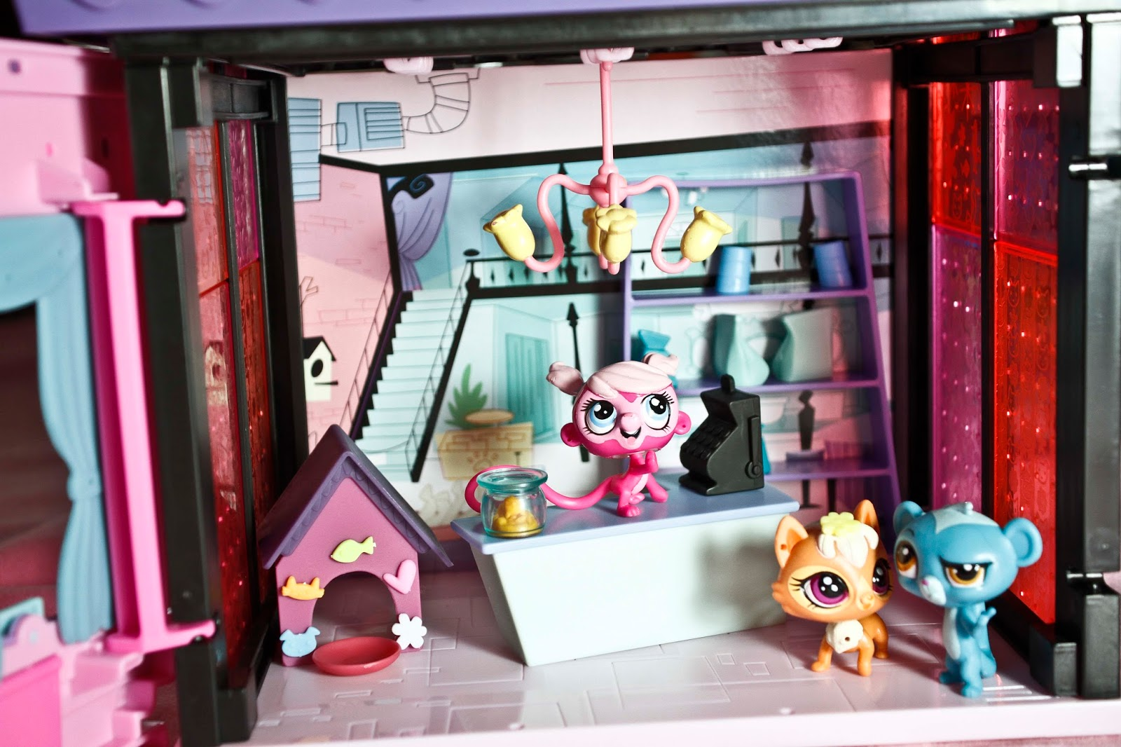 a set up showing some playgoing that can be done with the littlest pet shop style set