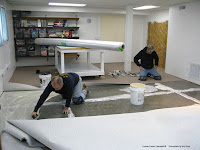 Installing the carpet in the new quilt studio
