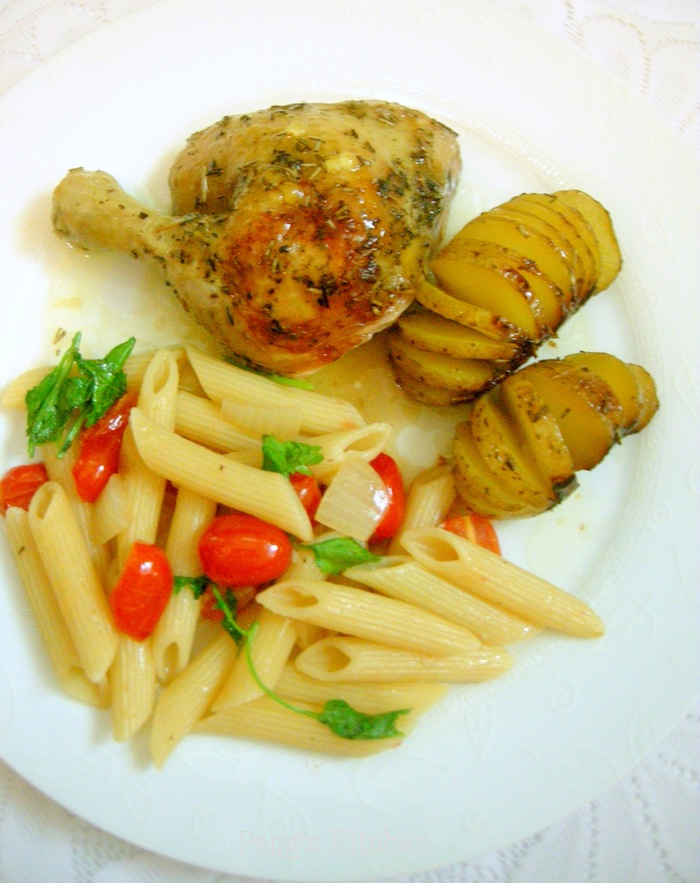 Roasted Mixed Herb Chicken served along with simple pan-fried Penne