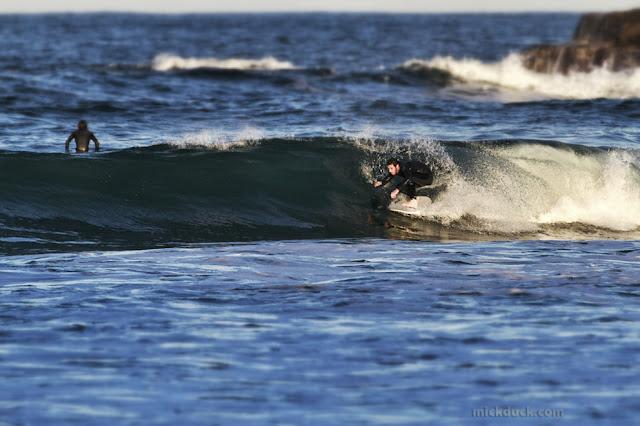 surfer surfing tube waves at geringong beach sydney australia
