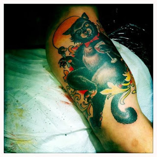 black cat tattoo meaning