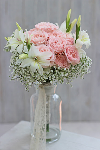 Bridal Bouquet with pink roses,Gypsophila and Gladiolus
