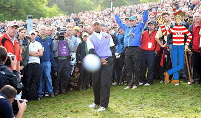 Tiger Woods fluffing a golf shot with am image of Wally superimposed