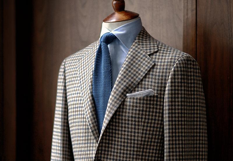 La chaqueta Tweed de cuadros.