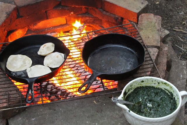 Pitta breads on the fire with nettle pesto