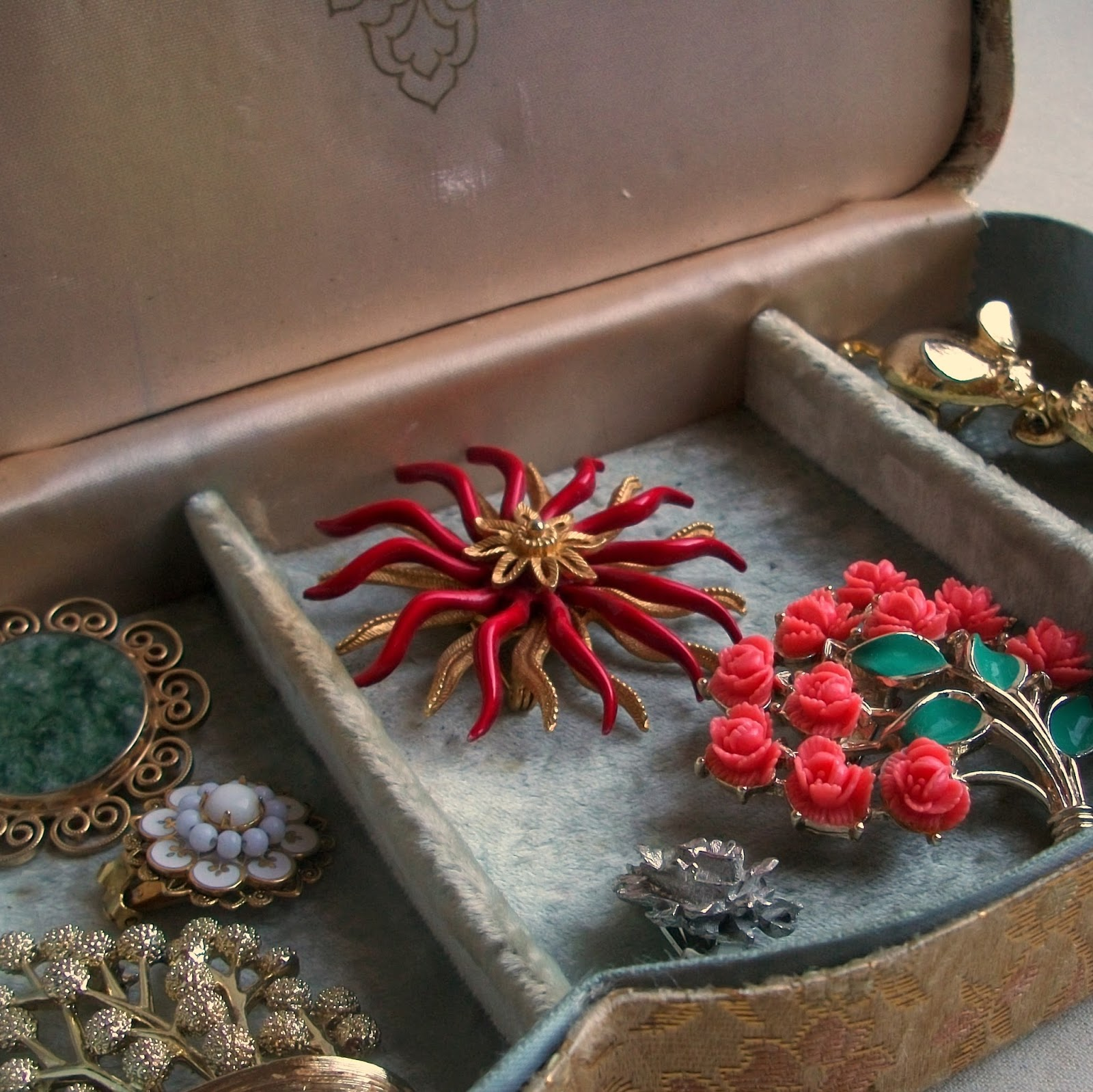 Jewelry Box with Vintage Brooches.