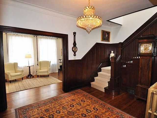 beautiful foyer with original wooden staircase in turn of the century home