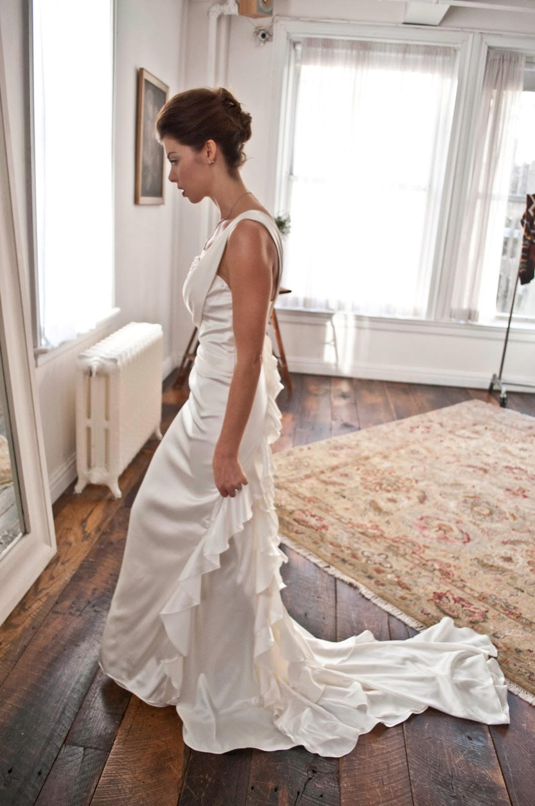 A Model Wedding, dress touch ups in loft full length mirror in profile