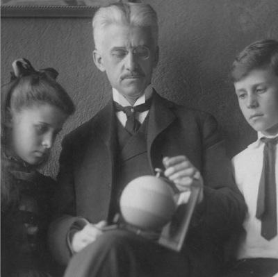 A. E. Munsell with children and Color Sphere