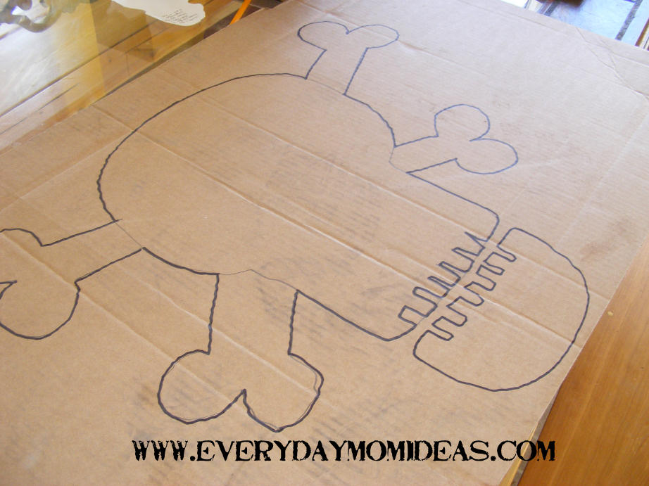Cardboard pirate door sign tutorial everyday mom ideas draw on your skull and crossbones template with a pencil dont worry about making it perfect if you mess up to badly you can just erase it and re draw it maxwellsz