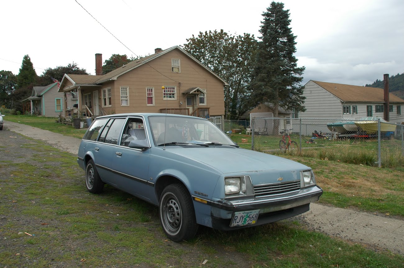 OLD PARKED CARS.: 1983 Chevy Cavalier Cadet Wagon.