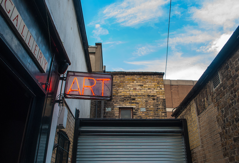 Back alley and art gallery sign being lit up in Dublin Ireland