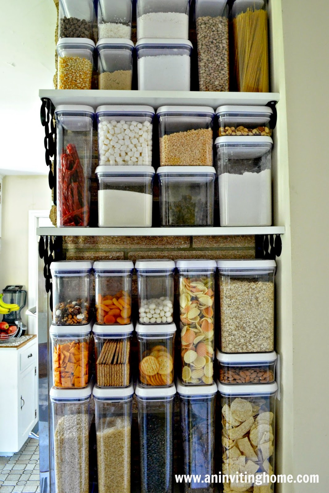 open shelving and containers turned into a pantry