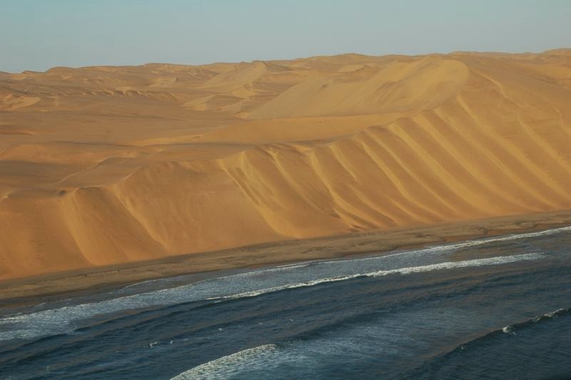 "The Namib is a coastal desert in southern Africa. The name Namib is of Nama origin and means ""vast place"". According to the broadest definition, the Namib stretches for more than 2,000 kilometres or 1,200 mi along the Atlantic coasts of Angola"