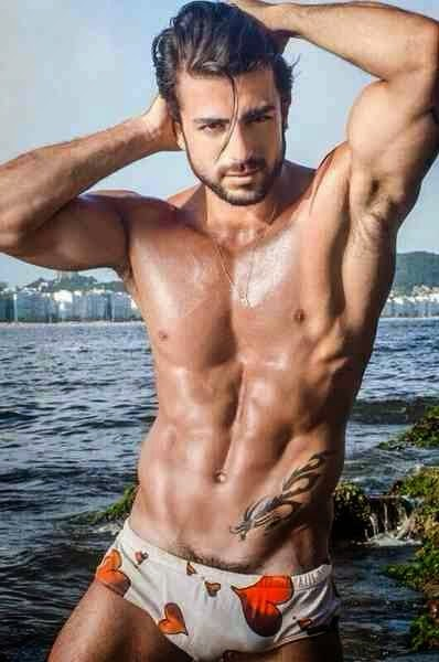 Muscular Man's Shaved Armpits at the Beach
