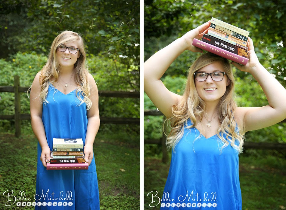 teen girl in blue dress holding a stack of books