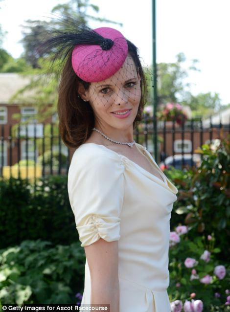 a lovely lady in hot pink hat with veil on day 5 of Royal Ascot 2014