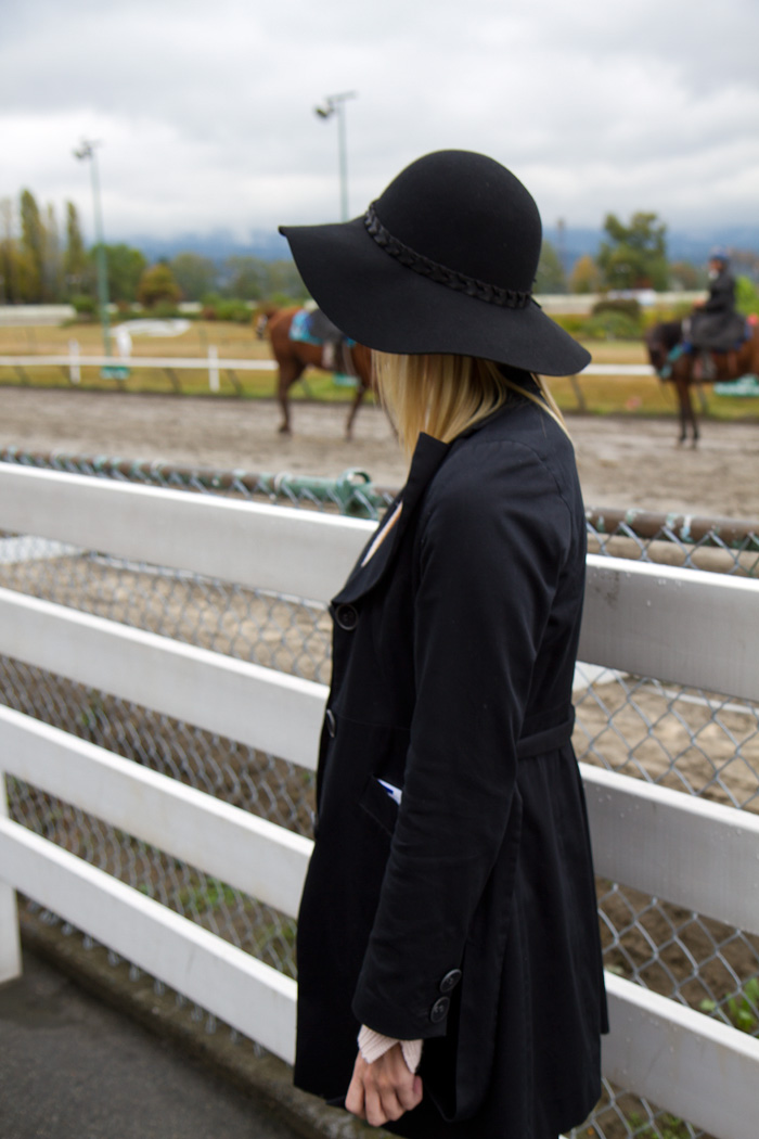 Vancouver Fashion Blogger, Alison Hutchinson, wearing Zara Black wide-brimmed hat, RW & Co navy blue trench coat, Zara pink knit sweater, Urban Outfitters black bodycon skirt, Zara black suede booties, Zara black tights, Essie 5th Avenue red nailpolish at Hastings Racetrack