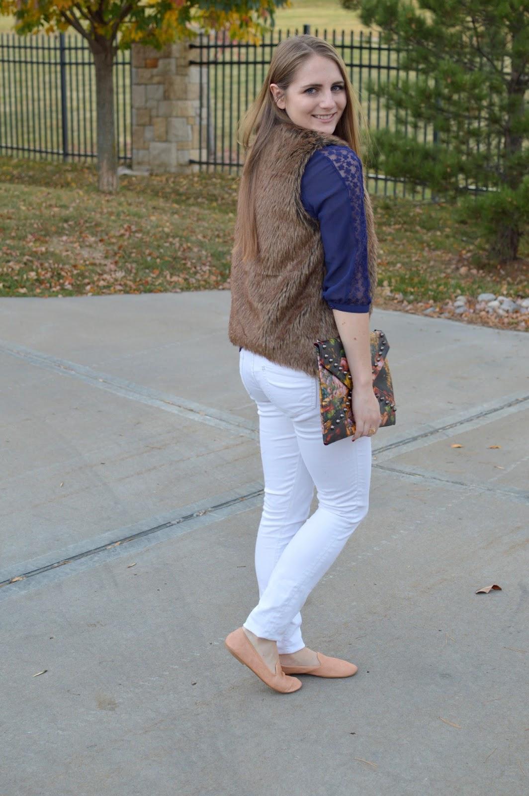 white jeans with a faux fur vest