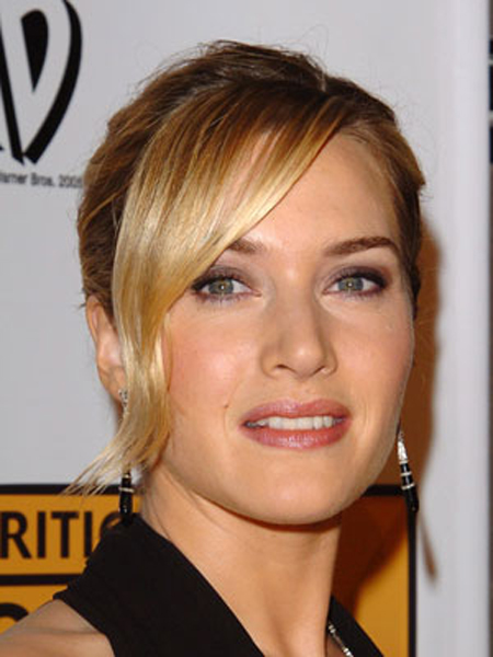 Kate WInslet sweeps back her smooth, silky hair for a simple, but elegant, evening style.