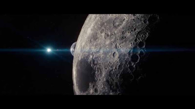 man of steel kal-el flies past the moon