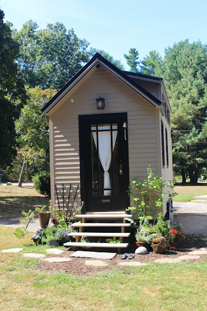 Tiny House with metal roof and cute siding :: OrganizingMadeFun.com